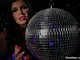 Romi Rain plays with a disco ball before stuffing toying her pussy