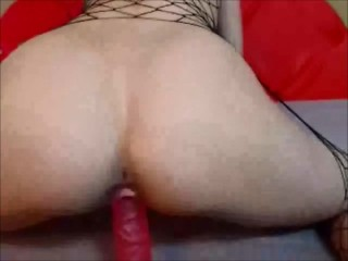 Fiery babe makes herself cum with a red sex toy