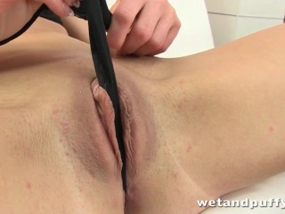 Dark haired babe fills her pussy with a red jelly dildo