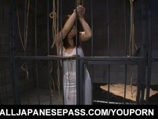 Nozomi Mitani is fucked with dildo and doggy behind the bars