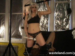 Kinky Mistress straps sex toy mask to her slave's face and rides it