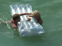 Picture Voyeur caught sex in the water on an air mat...