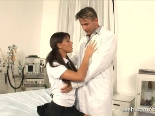 Sexy brunette babe drops to her knees and sucks the doctors hard dick