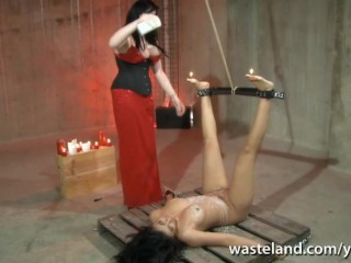 Bound brunette sex slave covered in hot wax by Lesbian Dominatrix