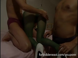 Oriental girl in ripped pantyhose bends over and sucks cock for two guys