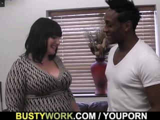 Busty lady boss in fishnets loves black meat