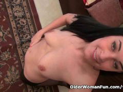 Picture American milf Nyla plays with her nyloned pu...