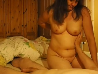 Mature woman helps him with wanking off