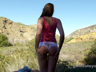 In shape brunette teen masturbates outdoors