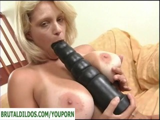 Busty milf with monster toy