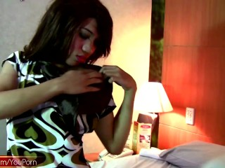 Cute ladyboy puts lotion in her ass and finger fucks herself