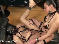 Picture Tranny fucking and whipping a slave in latex