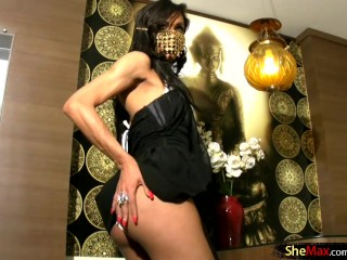 Small titted tranny performs striptease and flashes her ass