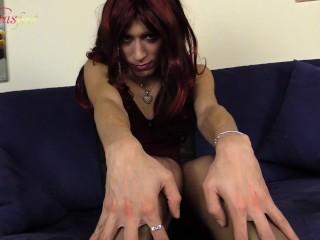 Redhead crossdresser shows her beautiful feet in black stockings