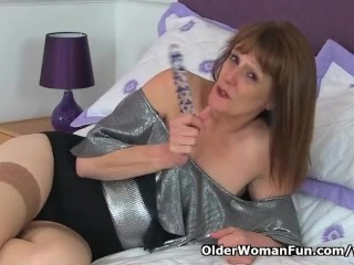 English gilf Pandora stuffs her old pussy with dildo