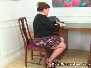 UK milf Vintage Fox gets busy at her desk