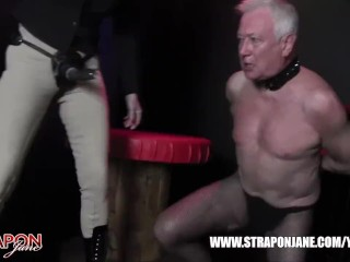 Femdoms in latex dominate tag team sissy slut face fuck strapons and masturbate his spunk into doggy bowl