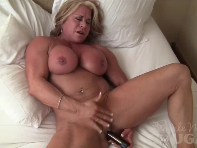 Naked in her bedroom with muscles taught and flexed