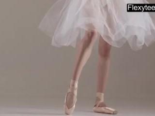 Teen/flex/gymnast performs gymnastics blonde