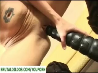 Blonde riding brutal dildo