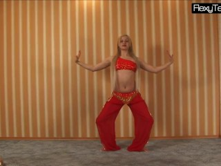 Sexy belly dancer in a red dress
