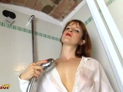 Redhead takes a shower...