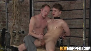 Tied up twink Kamyk Walker gets a handjob from Sean Taylor