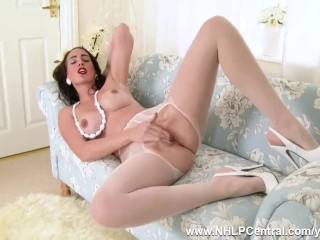 Leggy brunette Tammie Lee is no virgin in her white layered nylon pantyhose and heels fingering her slippery wet pussy