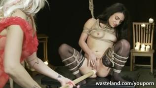 Bound Lesbian Femdom With A Dildo On A Stick