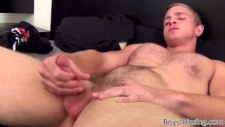 Hairy blond hunk masturbates while pissing on himself
