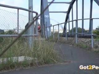 Public Pee - Hot babe relieves pee desperation near railway