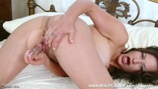 Kinky brunette Tindra Frost strips down to her sheer nylon pantyhose and heels to fuck herself hard with toy