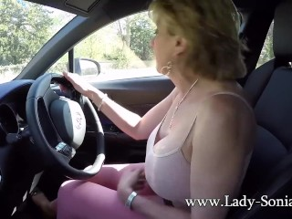 Old milf blonde Lady Sonia plays with her boobs while driving