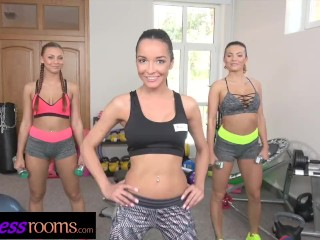 Fitness Rooms Sexy young gym girls share double ended dildo in threesome