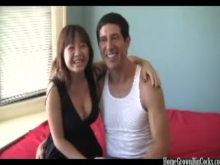 Big tit Asian amateur gets stuffed by a big white cock