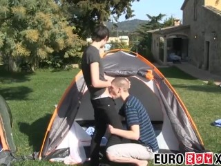 Cute couple sucking and bareback fucking outdoor in a tent