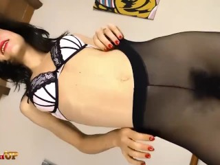 Brunette masturbating in pantyhose with her Magic Wand