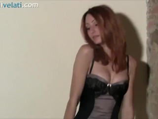 Redhead in short dress and Pantyhose on a stool
