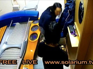 Two Hot Horns Girls in the tanning Salon together on the solarium, they masturbate together filmed Live Voyeur Hidden Cam
