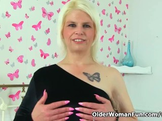 English milf Skyler is toying her shaven and creamy cunt