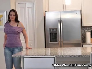 USA milf Christina Sapphire finger fucks herself in the kitchen
