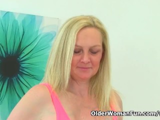 British milf Fiona plays with her boobs and fanny