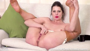 Horny Milf Karina Currie fucks herself with dildo toy in garter nylons and suspenders