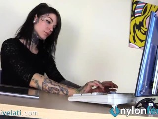Tattoed secretary in high heels and stockings lets you look under her table