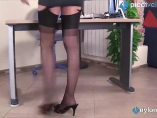 Redhead secretary in fully fashioned stockings seduces you