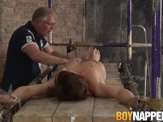 BDSM twink Casper Ellis submits big cock to handjob cumshot