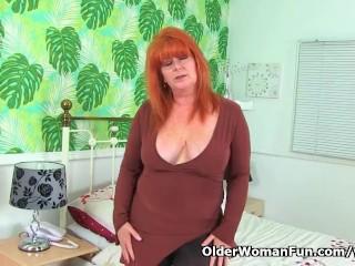 British milf Ginger Tiger toys her juicy cunt