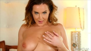 Natasha Nice makes her big boobs bounce while she striptease in her bed
