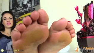2cc076980 Barefoot brunette gives herself a foot massage while her feet are in your  face