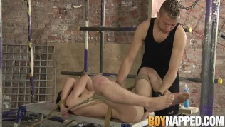 Restrained sub twink pumped with cock and dildo by dom